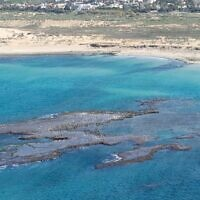Photographs of tar contamination along Israel's northern beaches, taken from a helicopter by Israel Nature and Parks Authority Director, Shaul Goldstein, on February 22, 2021.