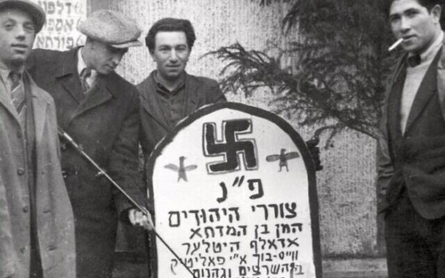 Purim with Holocaust survivors at the Landsberg DP camp in Germany, with a mock-tombstone for Haman and Hitler (Yad Vashem)