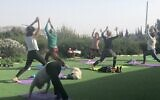 Yoga practice with Yoga Synagogue Ah!, a new community founded by Laura Gilinski (center, mauve shirt) during the coronavirus pandemic (Jessica Steinberg/Times of Israel)