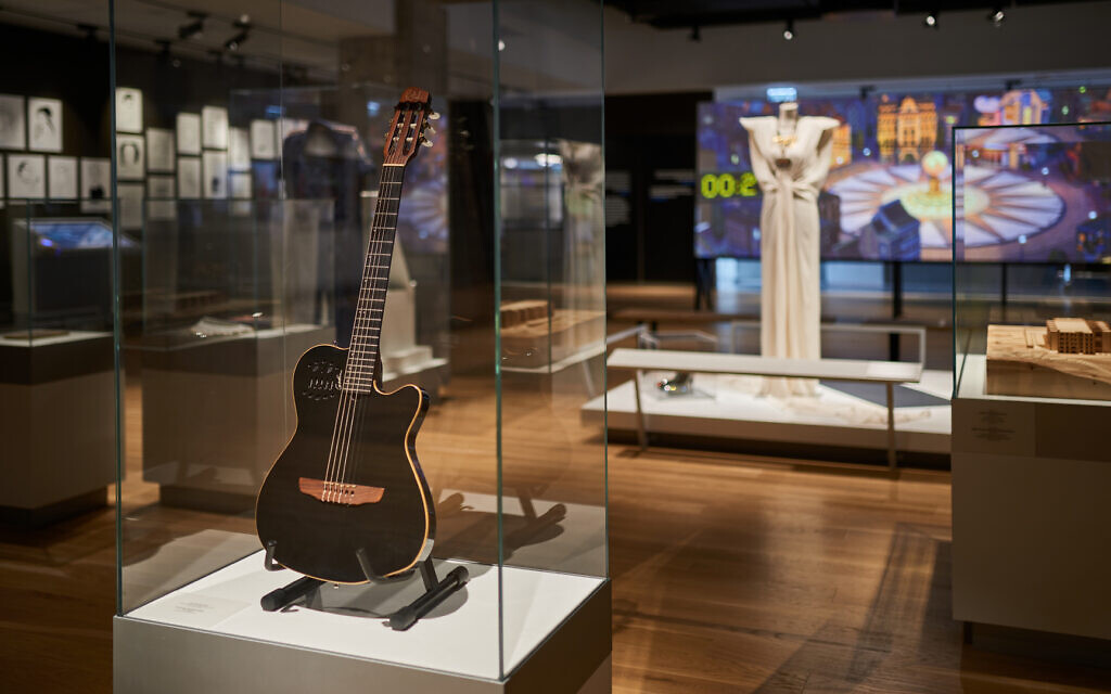 Musician Leonard Cohen's guitar from his final concert in Israel in 2009, on display at ANU Museum of the Jewish People, which opened March 10, 2021 (Courtesy Shahar and Ziv Katz)