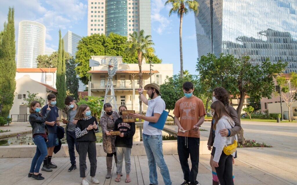 Taking a tour in Tel Aviv's Sarona complex, one of many being offered in the city over the Passover 2021 holiday (Courtesy Riki Rahman)