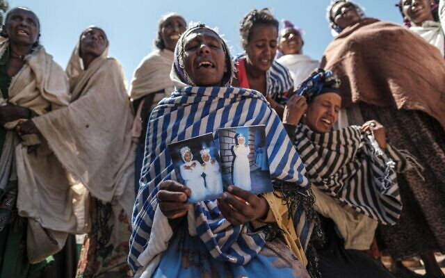 Women mourn the victims of a massacre allegedly perpetrated by Eritrean Soldiers in the village of Dengolat, North of Mekele,  the capital of Tigray on February 26, 2021.(EDUARDO SOTERAS / AFP)