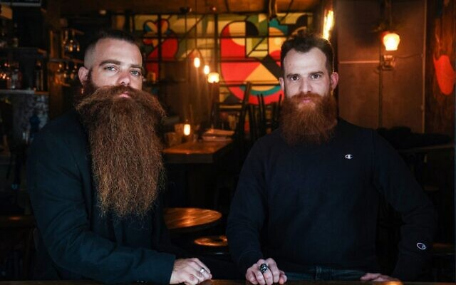 Bar Pinto (R) and Gilad Levi, two red-bearded 29-year-olds and founders of 'Beard for All' ('Ptor Zakan' in Hebrew), a campaign challenging Israeli military rules compelling all male troops to be cleanshaven, in Tel Aviv on February 7, 2021 (Emmanuel DUNAND / AFP)