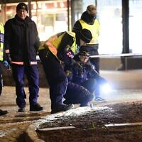 Police investigators work at the scene where a man attacked seven people, seriously injuring three, in the Swedish city of Vetlanda on March 3, 2021. (Mikael FRITZON / various sources / AFP)