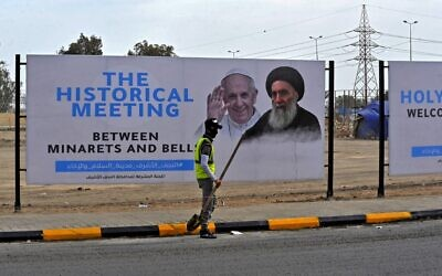 A hoarding of Pope Francis and top Iraqi Shiite cleric Grand Ayatollah Ali Sistani is pictured in Iraq's holy city of Najaf ahead of the Pope's visit to Iraq, on March 4, 2021. (Ali NAJAFI / AFP)