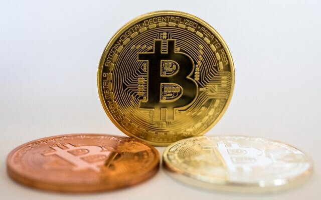 A visual representation of Bitcoin, at the 'Bitcoin Change' shop in Tel Aviv, February 6, 2018. (Jack Guez/AFP)