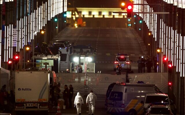 In this file photo taken on March 22, 2016 forensic police units and investigators are at work outside the Maalbeek metro station in Brussels, after a triple bomb attack at the airport and in the metro killed 32 people (NICOLAS MAETERLINCK / BELGA / AFP)