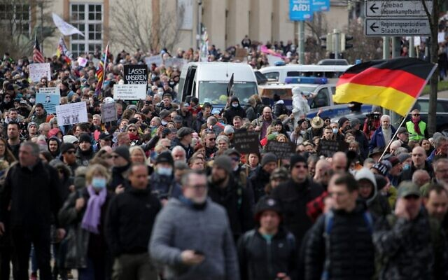 Protesters take part in a march demanding an end to the restrictive coronavirus measures in Kassel, Germany, on March 20, 2021. (Armando Babani/AFP)