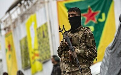 Fighters of the Kurdish-led Syrian Democratic Forces (SDF) take part in a military parade in the US-protected Al-Omar oil field in the eastern province of Deir Ezzor on March 23, 2021, marking the second annual anniversary of Baghouz's liberation from the Islamic State (IS) group. (Delil SOULEIMAN / AFP)