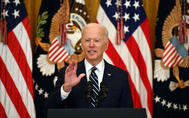US President Joe Biden answers a question during his first press briefing in the East Room of the White House in Washington, DC, on March 25, 2021. (Photo by Jim WATSON / AFP)