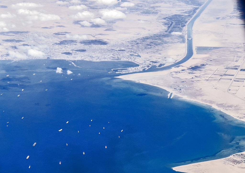 Tugboats sent speeding to Suez Canal to aid attempts to free megaship