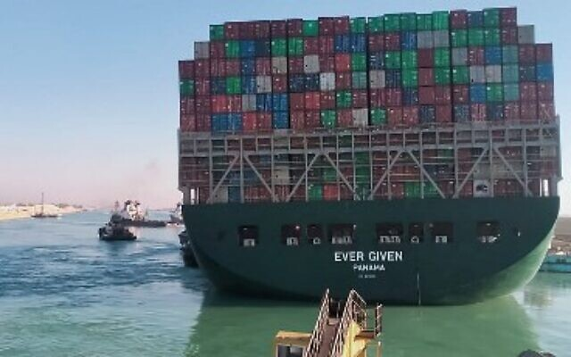 This picture taken on March 29, 2021 from a nearby tugboat in the Suez Canal shows a view of the Panama-flagged MV 'Ever Given' (operated by Taiwan-based Evergreen Marine) container ship as it begins to move. (AFP)