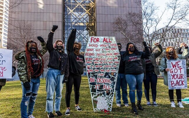 Members of Visual Black Justice protesters hold a rally outside the Hennepin County Government Center before the trial of former Minneapolis Police officer Derek Chauvin on March 29, 2021 in Minneapolis, Minnesota. (Photo by Kerem Yucel / AFP)