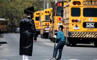 School buses lined up in the Williamsburg neighborhood of Brooklyn on April 24, 2019. (Johannes Eisele/AFP via Getty Images/JTA)