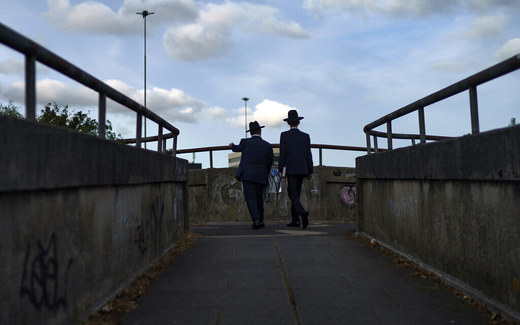 Two Jewish men make their way home from the Synagogue on the first day of Rosh Hashanah on September 18, 2020 in Gateshead, United Kingdom. (Christopher Furlong/Getty Images/via JTA)