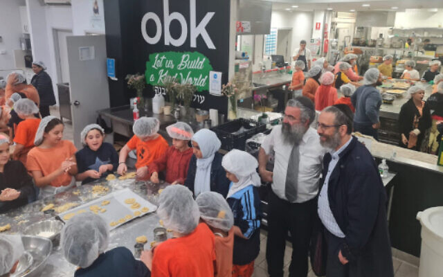 Children cooking at Our Big Kitchen to prepare food for people working to battle devastating flooding. (JTA/ Our Big Kitchen)