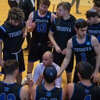 Coach Elliot Steinmetz instructs his Yeshiva University men's basketball team during its historic 2019-20 season. (YU Athletics)