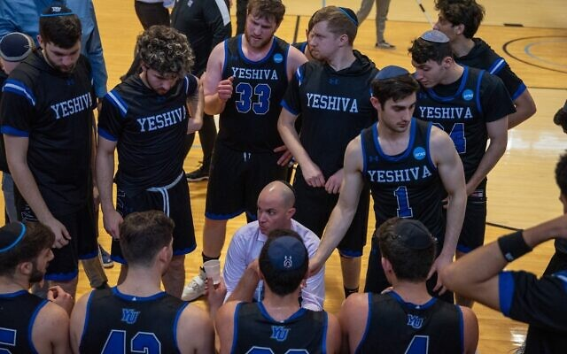 Coach Elliot Steinmetz instructs his Yeshiva University men's basketball team during its historic 2019-20 season. (YU Athletics)