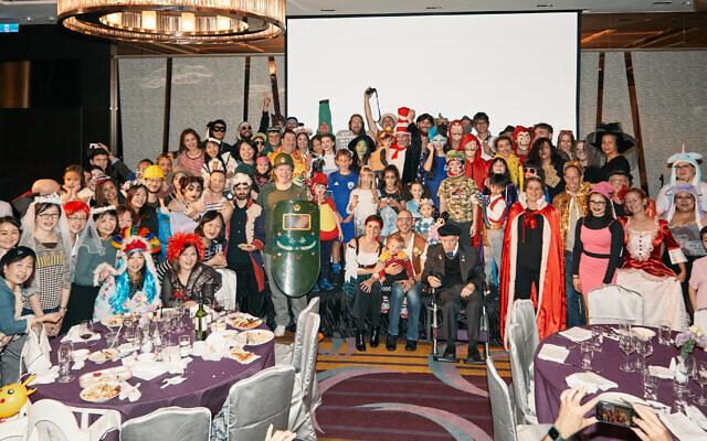 A group photo at the Jewish Community of Taiwan's 2021 Purim party. No masks required. (Archi Chang/ via JTA)
