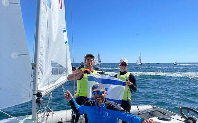 Gil Cohen and Noam Homri with coach Eran Sela (Israel Sailing Association)