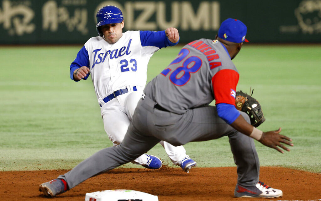 Illustrative: Israel's Sam Fuld (23) slides back to first safely as Cuba's first baseman William Saavedra prepares to tag in the seventh inning of their second round game of the World Baseball Classic at Tokyo Dome in Tokyo, March 12, 2017. (AP Photo/Shizuo Kambayashi)
