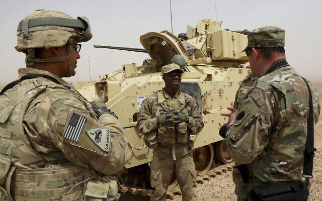 US soldiers participate in a joint drill with Jordan on April 26, 2018, in a training area near the town of Zarqa, east of Jordan's capital of Amman. (AP Photo/Raad Adayleh)