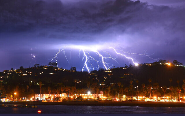 This time exposure photo provided by the Santa Barbara County Fire Department shows a series of lightning strikes over Santa Barbara, Calif., seen from Stearns Wharf in the city's harbor, Tuesday evening, March 5, 2019. A(Mike Eliason/Santa Barbara County Fire Department via AP)