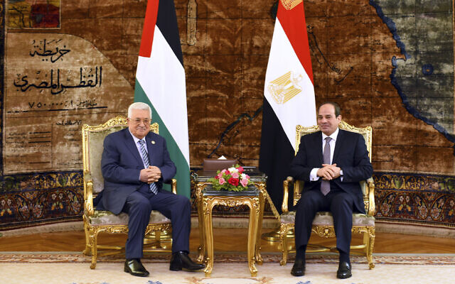 In this photo provided by Egypt's presidency media office, Egyptian President Abdel-Fattah el-Sissi, right, meets with Palestinian Authority President Mahmoud Abbas, Sunday, April 21, 2019, in Cairo, Egypt. (Egyptian Presidency Media office via AP)
