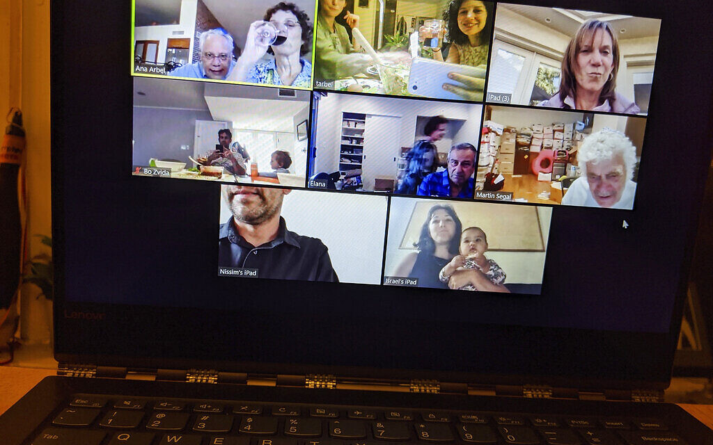 In this April 8, 2020, photo, Tali Arbel and her family and friends from other places are pictured on a New York computer screen during a virtual Seder for Passover. (AP Photo/Tali Arbel)