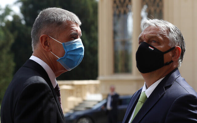 Prime Minister of the Czech Republic Andrej Babis, left, welcomes his Hungarian counterpart Viktor Orban for the V4 summit at the Lednice Chateau in Lednice, Czech Republic, June 11, 2020. (AP Photo/ Petr David Josek)