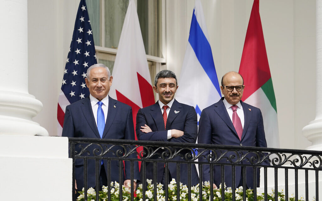 Then-prime minister Benjamin Netanyahu, United Arab Emirates Foreign Minister Abdullah bin Zayed al-Nahyan, and Bahrain Foreign Minister Khalid bin Ahmed Al Khalifa, stand on the Blue Room Balcony during the Abraham Accords signing ceremony on the South Lawn of the White House on September 15, 2020, in Washington. (AP Photo/Alex Brandon)
