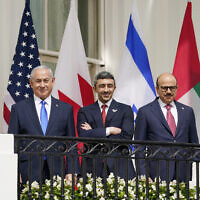 Then-prime minister Benjamin Netanyahu, United Arab Emirates Foreign Minister Abdullah bin Zayed al-Nahyan Abraham, and Bahrain Foreign Minister Khalid bin Ahmed Al Khalifa, stand on the Blue Room Balcony during the Abraham Accords signing ceremony on the South Lawn of the White House on September 15, 2020, in Washington. (AP Photo/Alex Brandon)