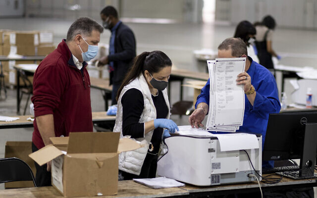 Illustrative: Workers scan ballots as the Fulton County presidential recount gets under way, November 25, 2020 at the Georgia World Congress Center in Atlanta. (AP Photo/Ben Gray)
