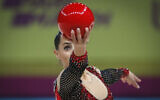 Linoy Ashram of Israel performs with the ball during the 36th European Rhythmic Gymnastics Championships in Kyiv, Ukraine, November 29, 2020. (AP Photo/Efrem Lukatsky)