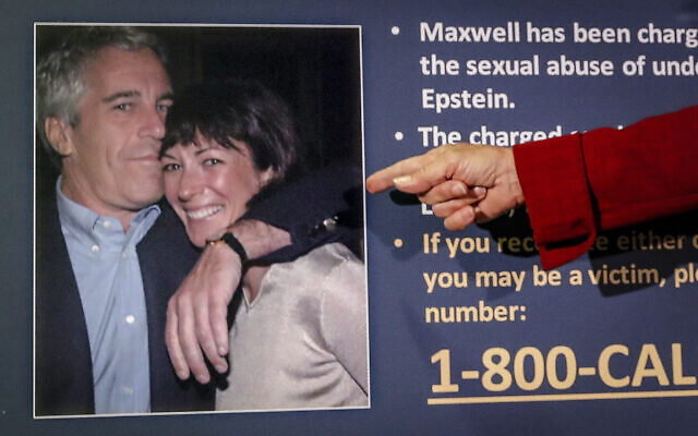 Audrey Strauss, acting US attorney for the Southern District of New York, points to a photo of Jeffrey Epstein and Ghislaine Maxwell during a news conference in New York, July 2, 2020. (John Minchillo/AP)