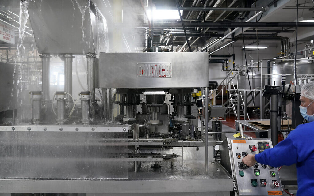 Foreman Dave Garthe runs boiling water through and over machinery in preparation for Hanan Products kosher-for-Passover production run, Thursday, Jan. 7, 2021, in Hicksville, N.Y. (AP/Seth Wenig)