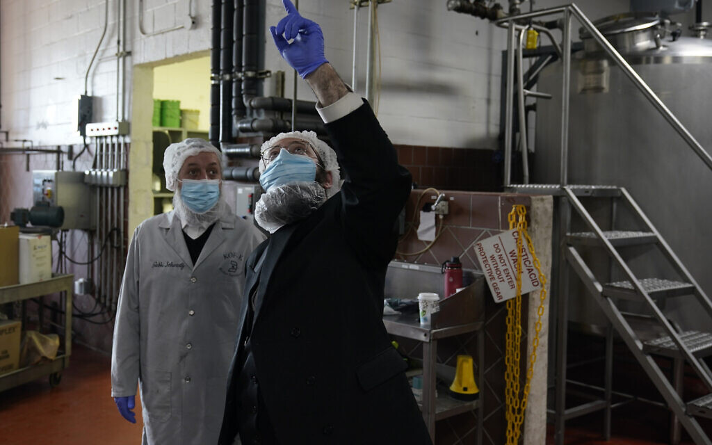 Rabbis Joseph Schwartz, left, and Mendel Einhorn confer as they supervise Hanan Products preparations for their kosher-for-Passover production run on Jan. 7, 2021, in Hicksville, N.Y. (AP Photo/Seth Wenig)