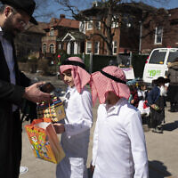 Illustrative: Boys are dressed in costumes for Purim, Friday, Feb. 26, 2021, in the Crown Heights neighborhood of New York.  (AP Photo/Mark Lennihan)