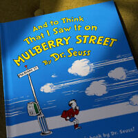 "A copy of the book ""And to Think That I Saw It on Mulberry Street,"" by Dr. Seuss, March 1, 2021, in Walpole, Massachusetts (AP Photo/Steven Senne)"