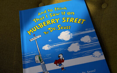 """A copy of the book """"And to Think That I Saw It on Mulberry Street,"""" by Dr. Seuss, March 1, 2021, in Walpole, Massachusetts (AP Photo/Steven Senne)"""