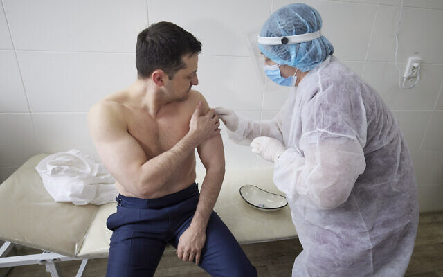 Ukrainian President Volodymyr Zelensky receives a dose of the AstraZeneca vaccine, marketed under the name CoviShield, as he visits the war-hit Luhansk region, eastern Ukraine, March 2, 2021. (Ukrainian Presidential Press Office via AP)