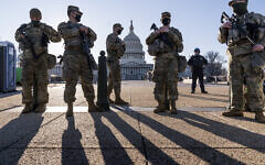 "Members of the Michigan National Guard and the US Capitol Police keep watch as heightened security remains in effect around the Capitol grounds since the Jan. 6 attacks by a mob of supporters of then-President Donald Trump, in Washington, Wednesday, March 3, 2021. The US Capitol Police say they have intelligence showing there is a ""possible plot"" by a militia group to breach the Capitol on Thursday. (AP Photo/J. Scott Applewhite)"