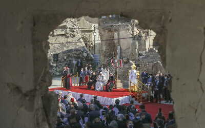 Pope Francis, surrounded by shells of destroyed churches, attends a prayer for the victims of war at Hosh al-Bieaa Church Square, in Mosul, Iraq, March 7, 2021. (AP Photo/Andrew Medichini)