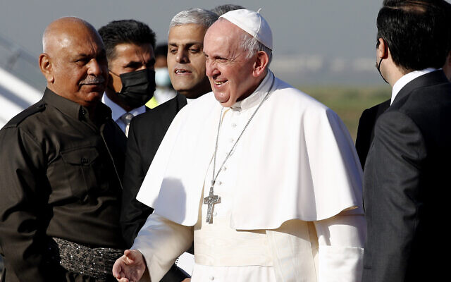 Pope Francis arrives at Irbil airport, Iraq, Sunday, March 7, 2021. (AP Photo/Hadi Mizban)