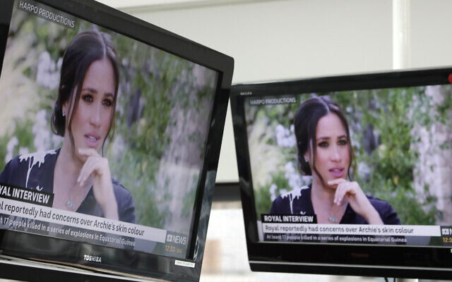 Australian television news in Sydney, Monday, March 8, 2021, reports on an interview of The Duke and Duchess of Sussex by Oprah Winfrey. The interview airs in Australia Monday evening. (AP Photo/Rick Rycroft)