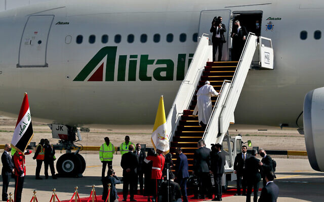 Pope Francis boards a plane upon concluding his visit to Iraq at Baghdad airport, Iraq, March 8, 2021. (AP Photo/Khalid Mohammed)