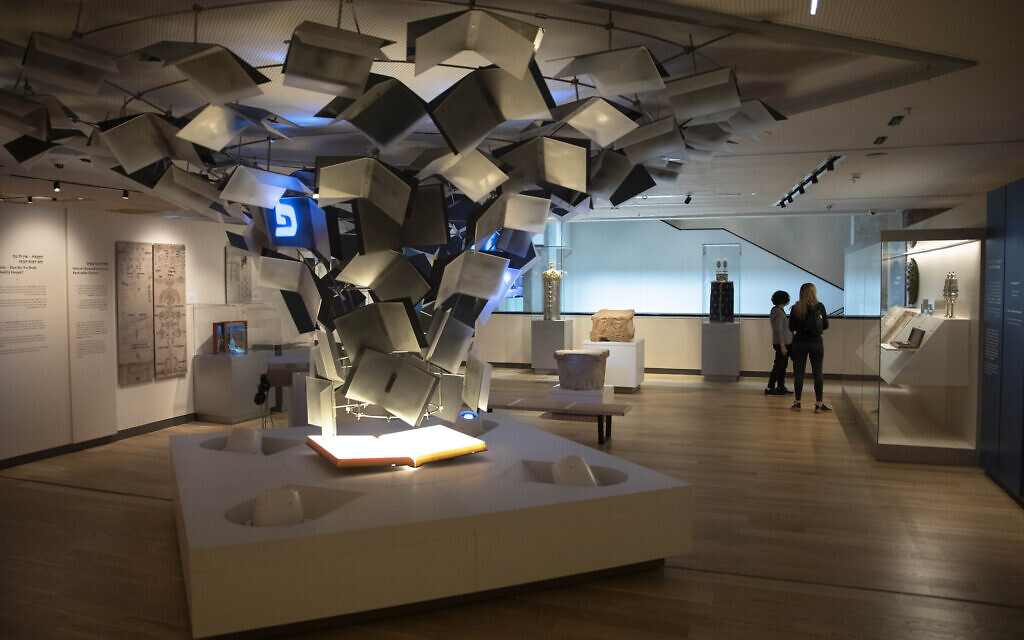 Visitors tour the Museum of the Jewish People in Tel Aviv on March 9, 2021. (AP Photo/Sebastian Scheiner)