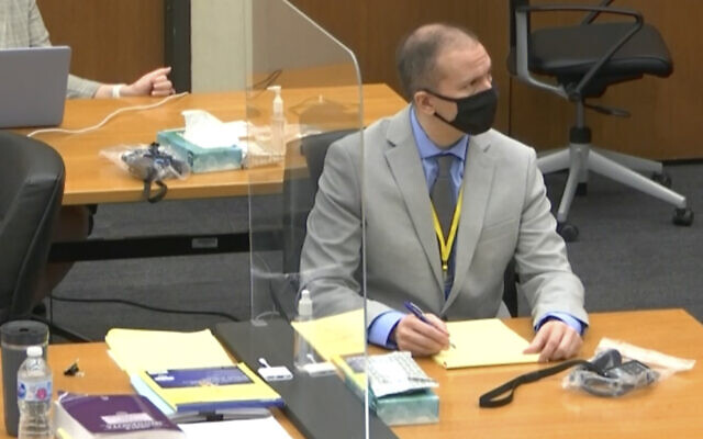 Defendant and former Minneapolis police officer Derek Chauvin, right, listens as Hennepin County Judge PeterCahill presides over pretrial motions before jury selection, March 9, 2021, at the Hennepin County Courthouse in Minneapolis. (Court TV screen capture, via AP, Pool)