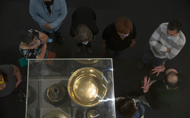 Visitors listen to a guide at the Museum for Islamic Art in Jerusalem, March 10, 2021. (Maya Alleruzzo/AP)