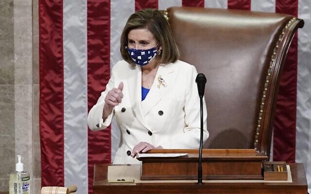 House Speaker Nancy Pelosi leads the vote to approve a landmark $1.9 trillion COVID-19 relief bill, at the Capitol in Washington, March 10, 2021. (AP Photo/J. Scott Applewhite)